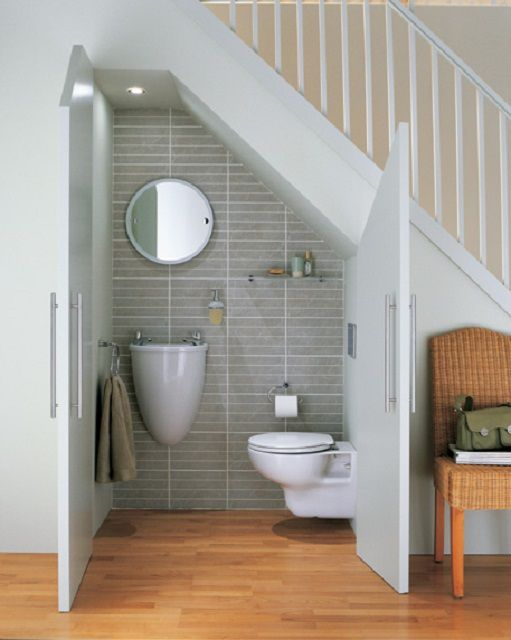 A bathroom under the stairs