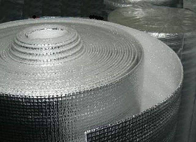 Roll material with clearly visible reinforcing fiberglass mesh