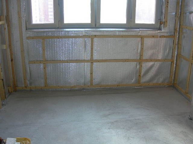 Insulating material , fixed to the walls