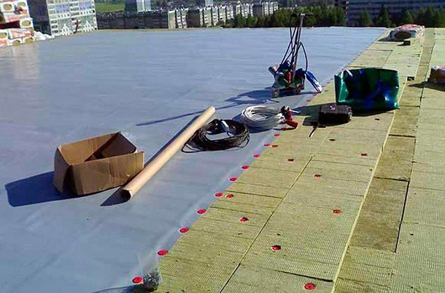 The membrane is laid on top of the multilayer waterproofing flat roofs