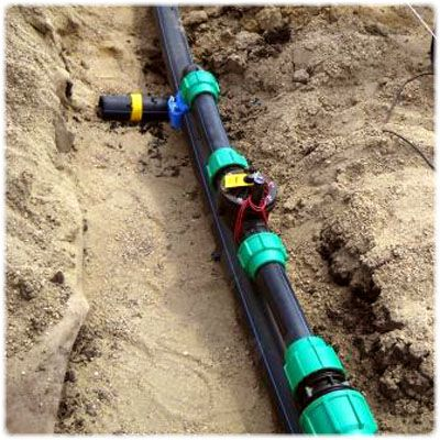 Carefully laid pipes and other elements of the system into a ditch