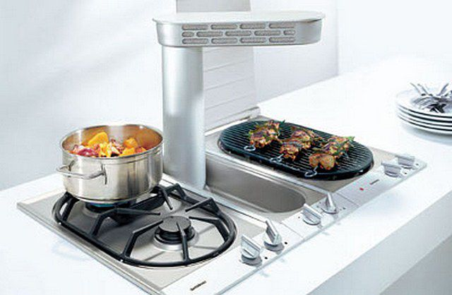 "A set of cooking - modules ""domino"" with two gas burners , hob with grill and kitchen built in hood in the middle."