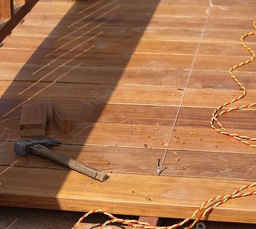 Installation of decking with their hands
