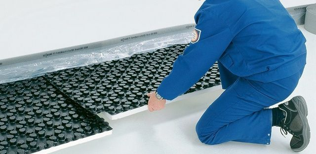 Mats with a film coating capable of creating a continuous waterproof surface
