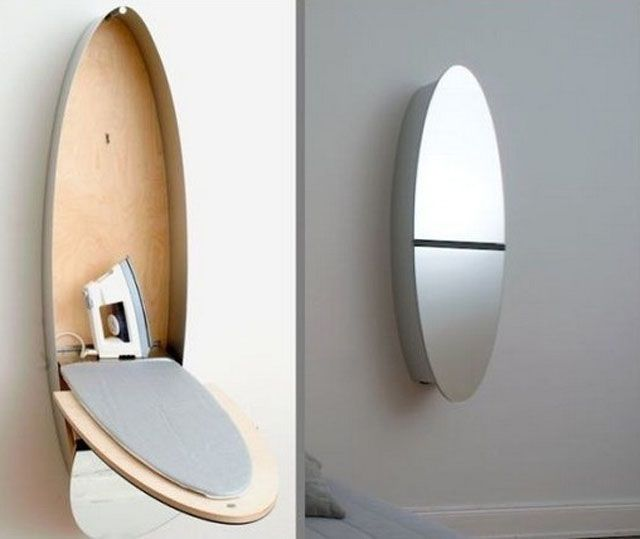 The original cabinet is transformed into an ironing board