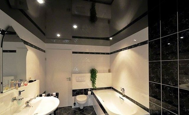 Glossy ceilings set up as if for decoration of bathrooms