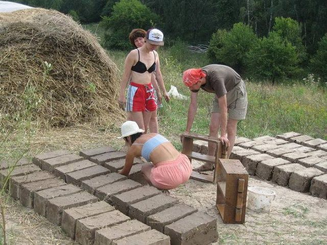 Making adobe bricks of clay and straw