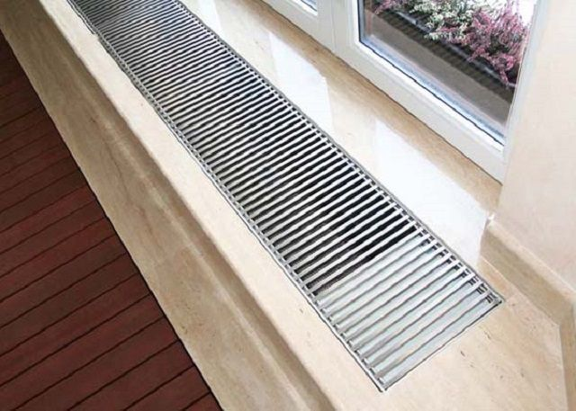 Convector , built into the window sill