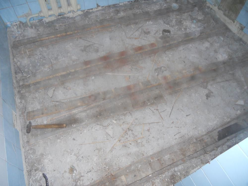 If the joists are very old , rickety and rotten , clean up all the concrete base