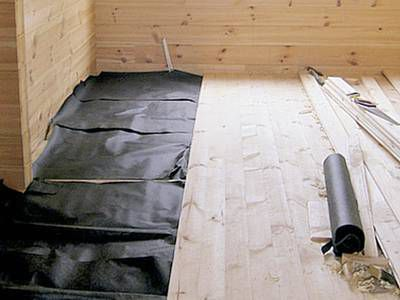 Waterproofing and laying the floor boards