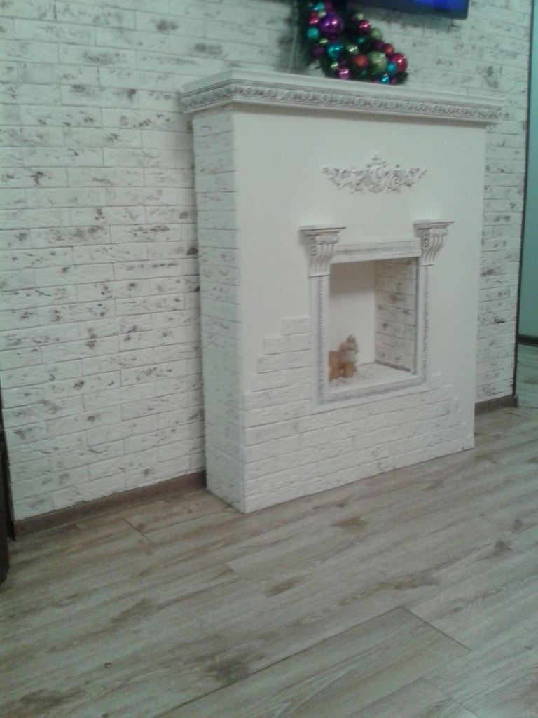 Decorative fireplace with his hands - side view