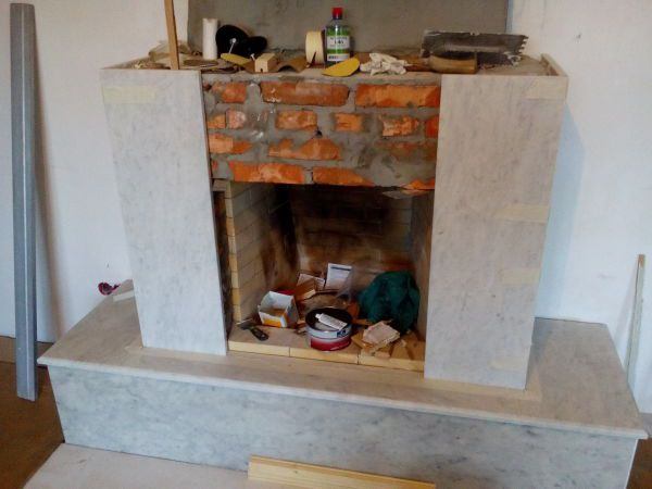Facing with marble fireplace