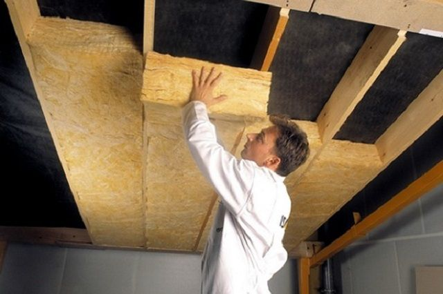 Laying of thermal insulation boards on the ceiling
