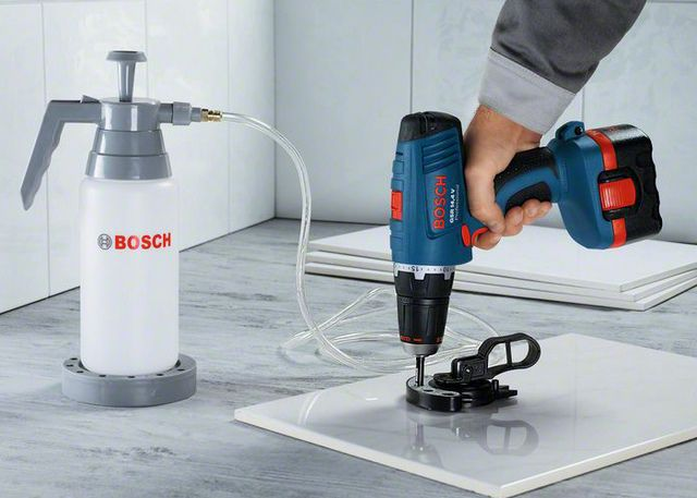 Drilling tiles with the conductor and forced injection of coolant