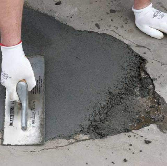 Patching potholes and cracks in the concrete base