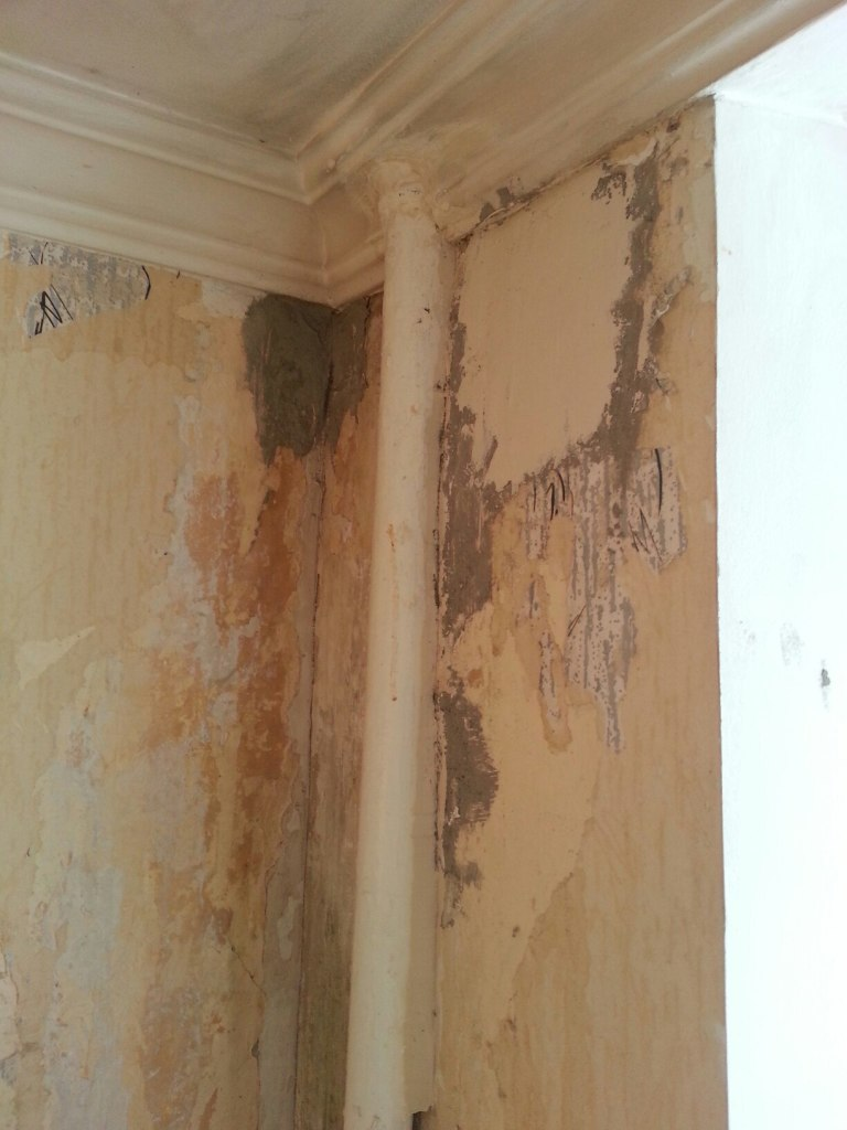 Plasterer large dents in the walls