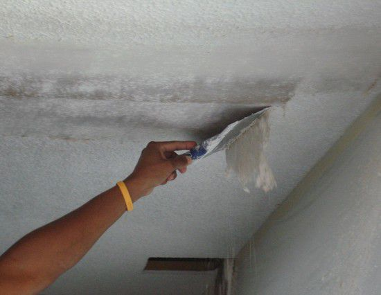 Cleaning the ceiling with a spatula