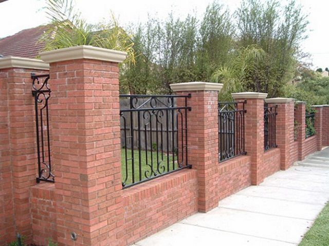 Brick pillars for the fence with his hands