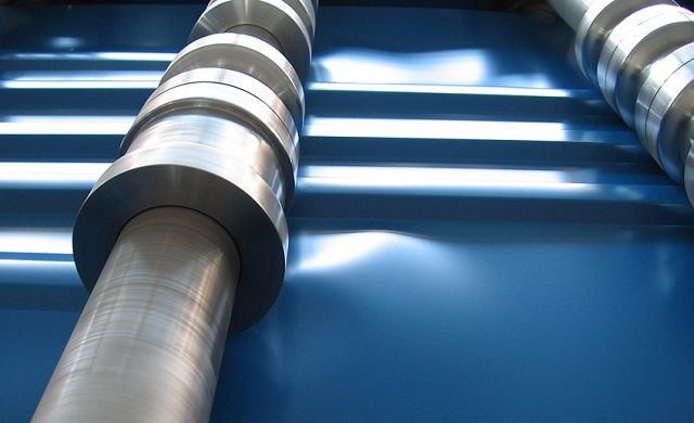 Production of corrugated sheets by rolling in a special machine