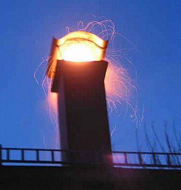 Scary picture - a sheaf of hot sparks from chimney
