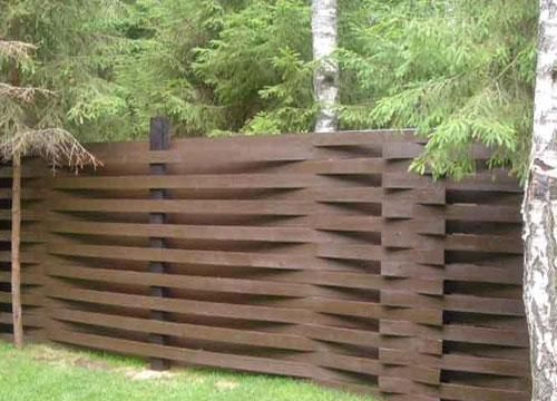 Fence braided from boards
