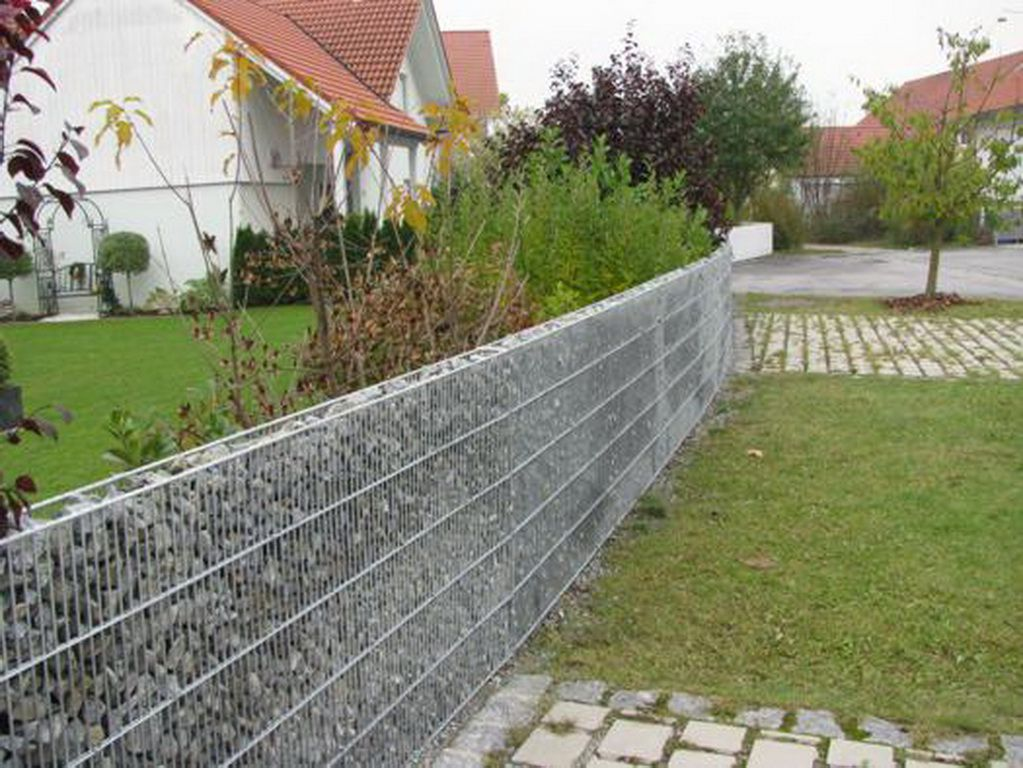Fence gabions - simple and original design that will protect and decorate a personal plot