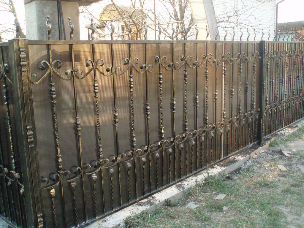 A fence made of polycarbonate with their hands