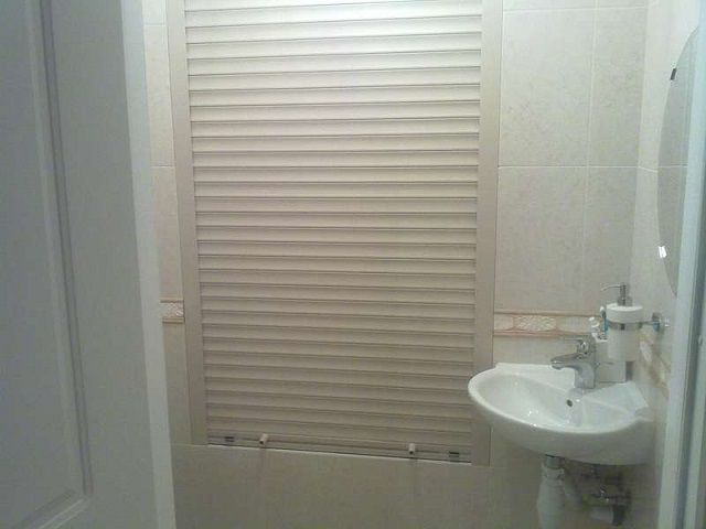 Close communication will help decorative trim wall , for example , with a shutter in the form of blinds