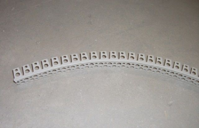 Perforated plastic profile for the finishing of corners