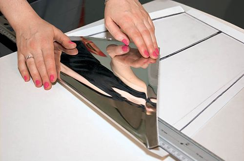 Cutting a mirror panel