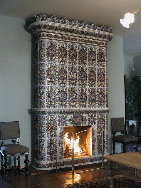 Fireplace , decorated tiles , turns into a real work of art