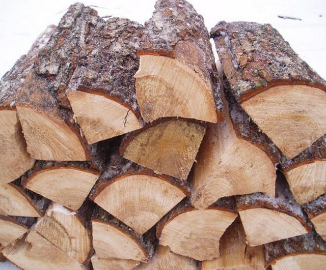 Coniferous wood give a lot of smoke and soot , burn quickly .For the stove - not the best option