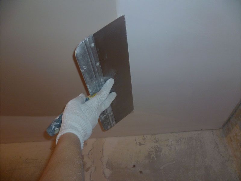 Plastered ceiling with his hands