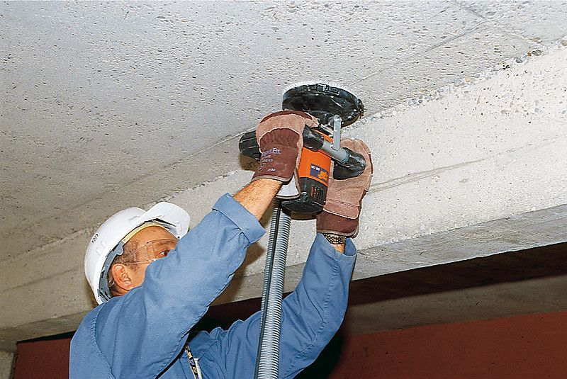 Cleaning the ceiling sander