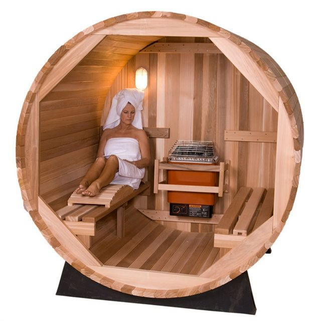 The interior of the barrel - sauna with electric stove