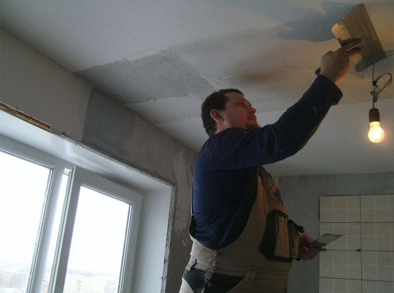 Plaster ceiling with his hands