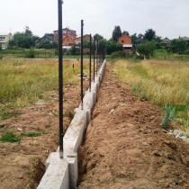 Construction of the foundation for the fence with his hands