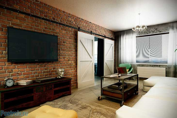 Interior 3 - room apartment.Living in a loft style.Brick wall and door coupe .A photo