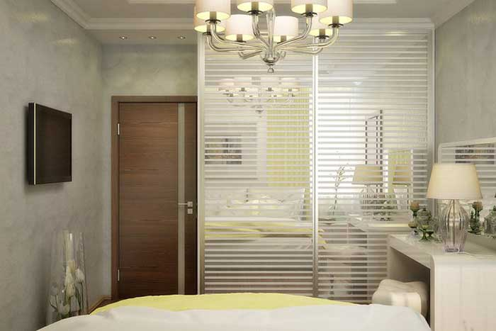 Sliding wardrobe in the bedroom with glass doors