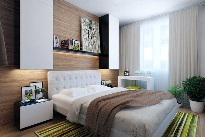 The design of modern bedroom .Suspended cabinets .Green carpet