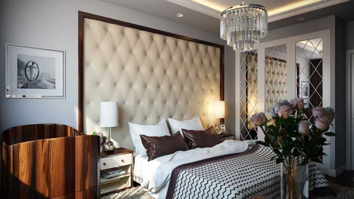 Interior design small bedroom .Gray walls and chocolate-colored cushion