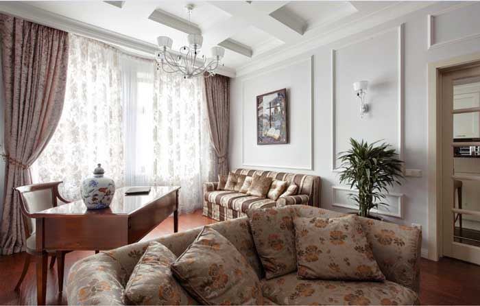 The walls are decorated with stucco , wallpaper for painting .The sofa in the classic interior