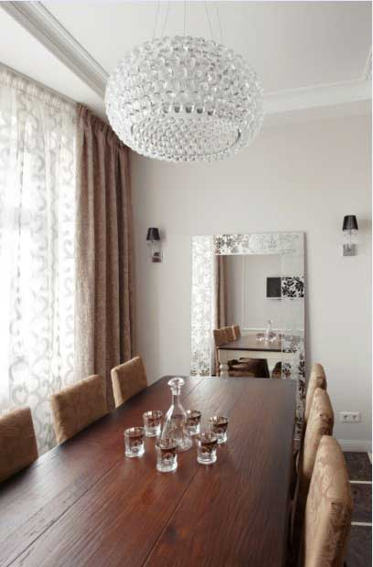 Large dining wooden table .Coffee curtains and mirror in classic style