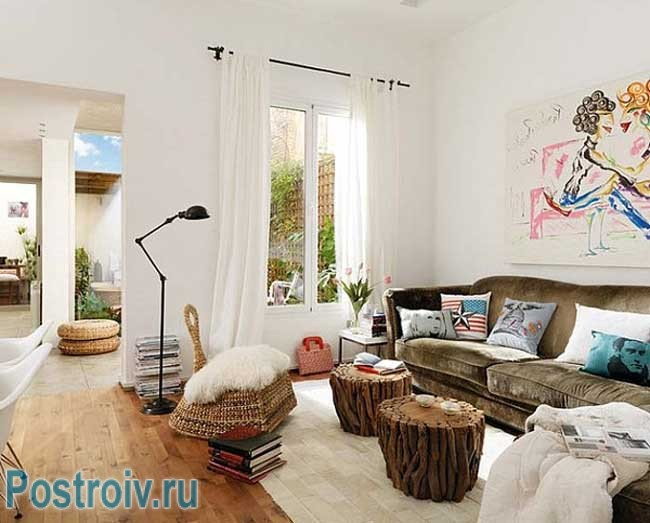 The white color of the walls in the living room in ecological style .tables of stumps