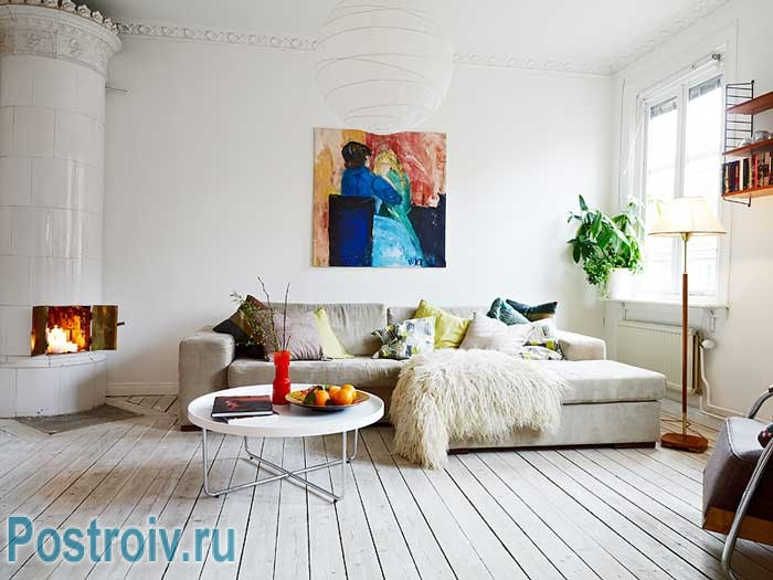 The spacious living room in white.Pop art painting on the wall