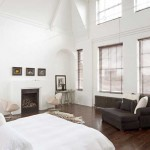 Large master bedroom with white walls.The home team will be delighted