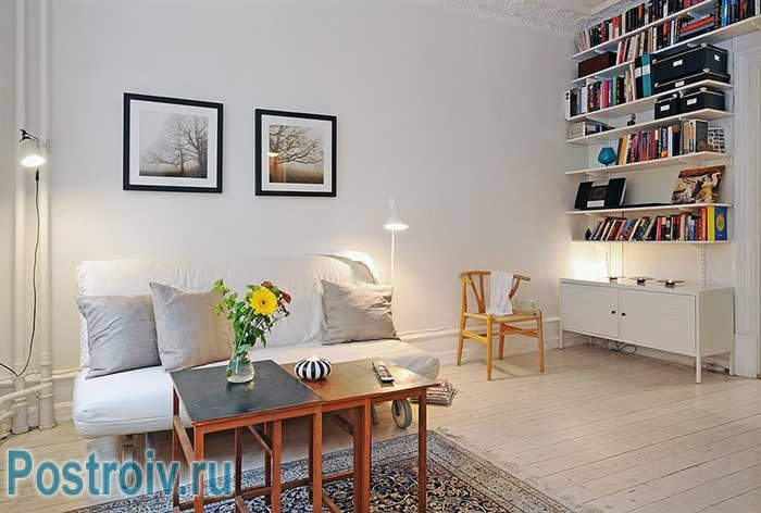 White walls decorated with paint .On the living room floor parquet