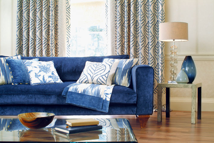 The velvet sofa in the living room blue