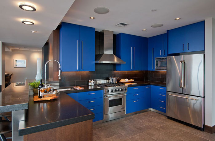 Kitchen renovated in blue in the style of hi -tech