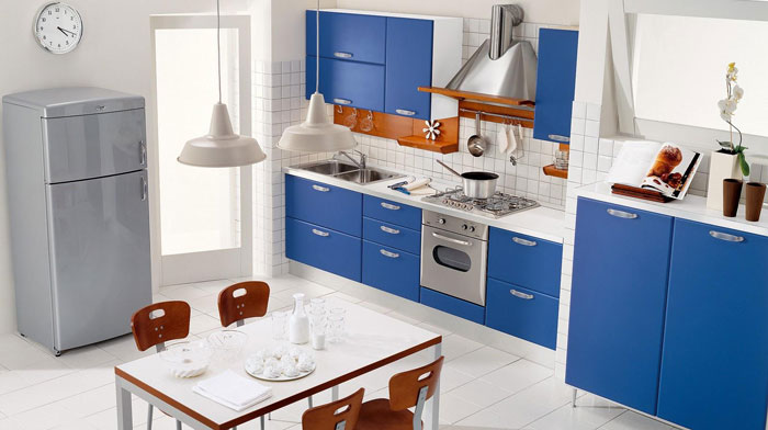 Interior blue kitchen with dining area .The combination of colors